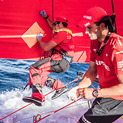 Leg 8 from Itajai to Newport, day 09 on board MAPFRE, Antonio Cuervas-Mons repairing a little hole in the sail with the help of Blair Tuke. 30 April, 2018.