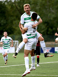 CORRECT CAPTION SHOULD READ: The New Saints Benjamin Cabango (bottom) celebrates scoring his side's third goal of the game during the UEFA Champions League, first qualifying round, second leg match at Park hall, Oswestry.