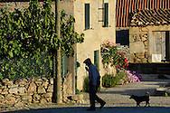 old man and dog in a village in the Faia Brava reserve, Coa valley, Portugal, Western Iberia rewilding area
