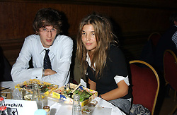 ISAAC FERRY and SCARLETT STRUTT at a quiz night in aid of RAPt ( The Rehabilitation for Addicted Prisoners Trust) held at Hammersmith Town Hall, King Street, London W6 on 14th November 2005.<br /><br />NON EXCLUSIVE - WORLD RIGHTS