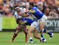 Leeds Rhinos' Brett Ferres and Joel Moon tackle Castleford's Grant Millington during the Betfred Super League match at the Mend-A-Hose-Jungle, Castleford.