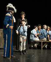 """Oliver (Tyler Browne) asks """"for more"""" from Mr. Bumble (Roland Dubois) during dress rehearsal for the Streetcar Company's production of """"Oliver"""" at the Interlakes High School auditorium Thursday evening.  (Karen Bobotas/for the Laconia Daily Sun)"""