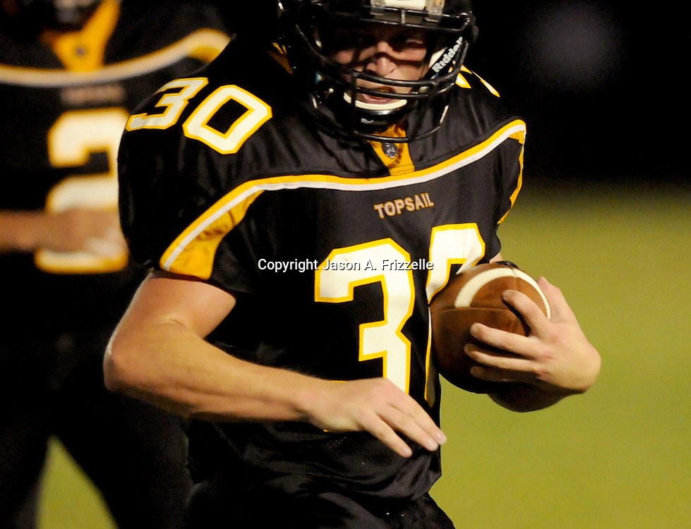Topsail High School's Collin Radley rushes against Pender High School Friday August 30, 2013 at Topsail High School. (Jason A. Frizzelle) This collection of images is from the 2013 High School Football in the Cape Fear region.