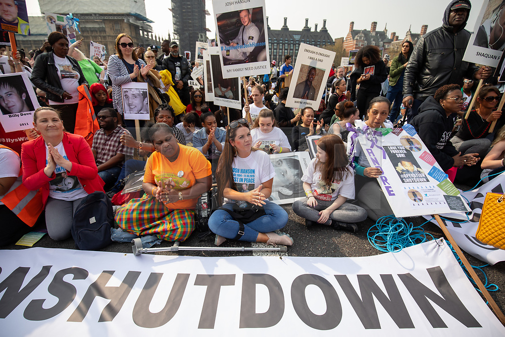 © Licensed to London News Pictures. 17/04/2019. London, UK. An anti-knife crime march demonstration named 'Operation Shutdown' sit on Westminster Bridge to listen to speeches. The demonstration was called following a rise in knife crime and violence in the capital. Speakers include family members of those lost to knife crime. Photo credit : Tom Nicholson/LNP