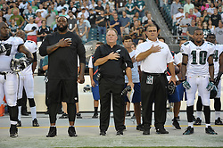 PHILADELPHIA, PA - AUGUST 09: Jason Peters, coach's Chip Kelly Jeff Stoutland of the Philadelphia Eagles observe the national anthem before the game against the New England Patriots at Lincoln Financial Field on August 9, 2013 in Philadelphia, Pennsylvania. (Photo by Drew Hallowell/Philadelphia Eagles/Getty Images) *** Local Caption *** Jason Peters;Chip Kelly;Jeff Stoutland
