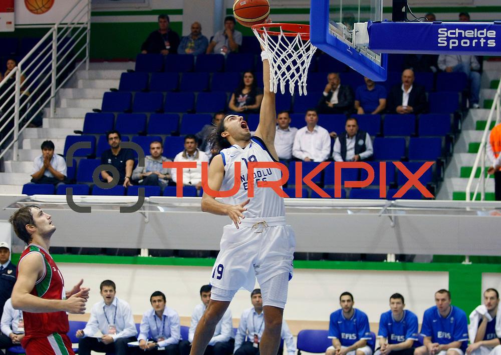 Anadolu Efes's Sasha VUJACIC (R) during their Turkey Cup Qualifying basketball second match Anadolu Efes between Pinar Karsiyaka at Aliaga Arena in Izmir, Turkey, Monday, October 10, 2011. Photo by TURKPIX