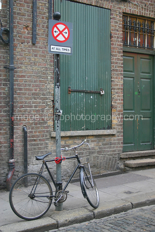 bicycle locked to no parking sign in Temple Bar, Dublin, Ireland