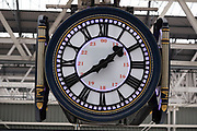 The famous clock at Waterloo Station on 28th January 2021 in London, United Kingdom. The four-faced clock hangs in the middle of the main concourse. Meeting 'under the clock at Waterloo' is a traditional rendezvous.