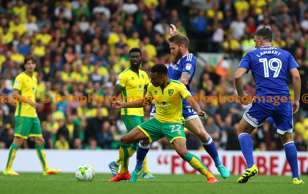 Jacob Murphy of Norwich City (yellow) tussles with Aron Gunnarsson of Cardiff City during the Sky Bet Championship match between Norwich City and Cardiff City at Carrow Road in Norwich. September 10, 2016.<br /> Arron Gent / Telephoto Images<br /> +44 7967 642437