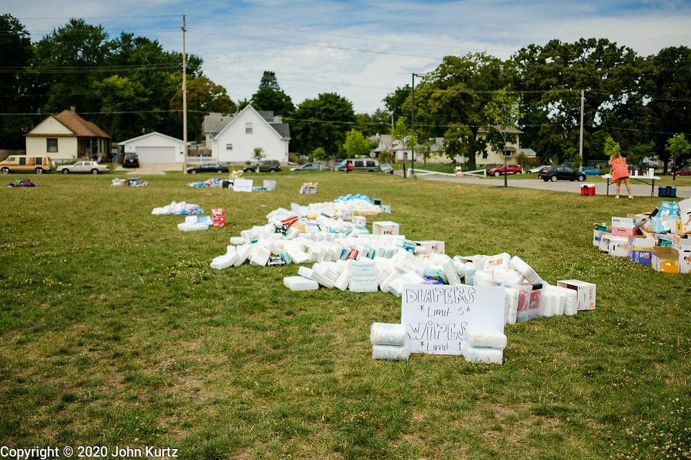 """19 JULY 2020 - DES MOINES, IOWA: Donated goods available during """"A Celebration of Black Motherhood"""" in Des Moines Sunday. The event was organized by the Supply Hive and Black Lives Matter. Items were donated by members of the community and redistributed to at risk families. They distributed diapers, sanitary products, clothes, books, and toys. They had enough material to help 200 families.         PHOTO BY JACK KURTZ"""