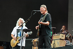 "© Licensed to London News Pictures. 12/07/2014. London, UK.   Neil Young and Crazy Horse performing live at Hyde Park as part of the British Summer Time series of outdoor concerts.In this picture - Neil Young (centre), Frank Sampredo (left).   Crazy Horse is a rock band long associated with Neil Young,  consisting of members Rick Roses, (bass, vocals), Ralph Molina (drums, vocals), Frank ""Poncho"" Sampedro ( guitar, organ, keyboards).  Photo credit : Richard Isaac/LNP"