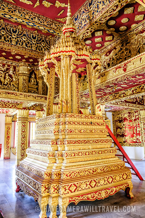 An ornate gold pedestal at Haw Pha Bang (or Palace Chapel) at the Royal Palace Museum in Luang Prabang, Laos. The chapel sits at the northeastern corner of the grounds. Construction started in 1963.