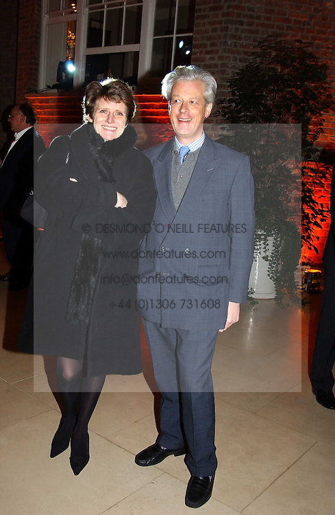 LORD & LADY KENILWORTH at a party to celebrate the 2nd anniversary of Quintessentially magazine held at Asprey, Bond Street, London on 24th February 2005.<br />