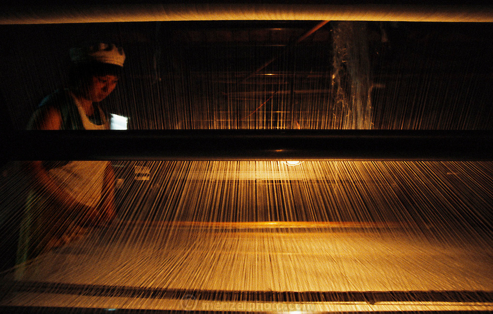 Silk factory loom and weaver. Suzhou, China.