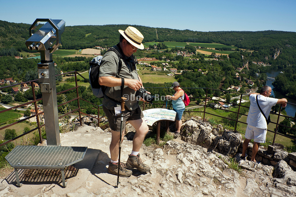 tourists at Saint Cirq Lapopie in the Languedoc region of south France