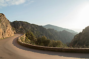 View of road on mountains between rocks, Calanches de Piana, Corsica, France