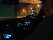 Mann raucht am fruehen Morgen im freien eine Zigarette auf dem Weg zur Jagd in der sibirischen Taiga. Jakutsk hat 236.000 Einwohner (2005) und ist Hauptstadt der Teilrepublik Sacha (auch Jakutien genannt) im Foederationskreis Russisch-Fernost und liegt am Fluss Lena. Jakutsk ist im Winter eine der kaeltesten Grossstaedte weltweit mit bis zu durchschnittlichen Wintertemperaturen von -40.9 Grad Celsius.<br /> <br /> Man smoking outside a cigarette during an early morning leaving hunting to the Siberian taiga. Yakutsk is a city in the Russian Far East, located about 4 degrees (450 km) below the Arctic Circle. It is the capital of the Sakha (Yakutia) Republic (formerly the Yakut Autonomous Soviet Socialist Republic), Russia and a major port on the Lena River. Yakutsk is one of the coldest cities on earth, with winter temperatures averaging -40.9 degrees Celsius.