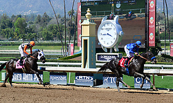 March 29, 2018 - Arcadia, California, USA - Horse Racing - LONGDEN (GB) with jockey DRAYDEN VAN DYKE cross the finish first followed by FORMAL DUDE with jockey TIAGO JOSUE PERIERA in the 6th race   at Santa Anita Race Track, Arcadia, California, USA, March 29, 2018...Credit Image  cr  Scott Mitchell/ZUMA Press (Credit Image: © Scott Mitchell via ZUMA Wire)