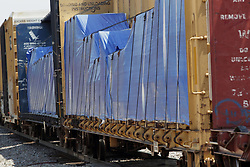A freight train travels past the Amtrak Depot in Galesburg Illinois