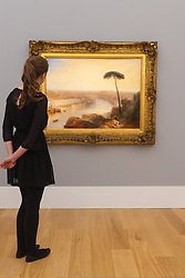 Sotheby's London, November 28th 2014.Sotheby's hold a preview for their December 3rd sale of Old Master and British Paintings at their Bond Street gallery. The exhibition runs from November 29th to December 3rd. PICTURED: A woman admires  Turner's Rome, From Mount Aventine, the Star Lot in the auction with bids expected to be in the region of £15-20 million.
