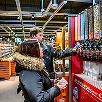 """Nederland, Purmerend , 2 november 2016.<br /> Vandaag ging de Albert Heijn XL in Purmerend weer open na een ingrijpende verbouwing van twee weken. In de allernieuwste XL van Nederland wordenklanten volop geïnspireerd door nieuw assortiment en innovatieve concepten. Vers speelt een hoofdrol in de nieuwe Albert Heijn XL. Klanten zien door de hele winkel vernieuwende versconcepten zoalsverse vis op ijs en een sappen- en yoghurtbar. De winkeltrip wordt een beleving met de 'chooseityourself'-concepten zoalskruiden plukken inde kruidentuin, schaal- en schelpdieren scheppen of je favorietehagelslagsamenstellen.En door een fors aantal energiebesparende maatregelen mag de XL in Purmerend zich vanaf vandaag de duurzaamste supermarkt van Europa noemen.<br /> <br /> Netherlands, Purmerend, November 2, 2016.<br /> <br /> Today, dutch supermarket Albert Heijn XL in Purmerend reopened after an extensive renovation of two weeks. In the latest XL Netherlands customers are fully inspired by new product ranges and innovative concepts. Fresh plays a key role in the new Albert Heijn XL. Throughout the store customers see fresh innovative concepts such as fresh fish on ice and juice and yoghurtbar. The shopping trip is an experience with the """"choose it yourself 'concepts such as picking herbs in the herb garden, seafood or create your favorite chocolate sprinkles assemblies. And with the a large number of energy saving measures Albert Heijn XL Purmerend may call itself as of today the most sustainable supermarket in Europe.<br /> <br /> Foto: Jean-Pierre Jans"""