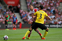 Football - 2016 / 2017 Premier League - Southampton vs. Watford<br /> Southampton's Dusan Tadic gets fouled by Miguel Britos of Watford at St Mary's Stadium Southampton <br /> <br /> Colorsport/Shaun Boggust