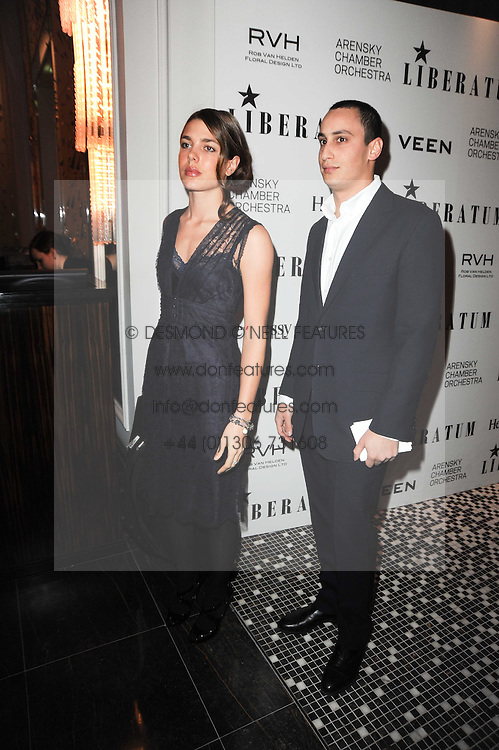 CHARLOTTE CASIRAGHI and ALEX DELLAL at the Liberatum Dinner hosted by Ella Krasner and Pablo Ganguli in honour of Sir V S Naipaul at The Landau at The Langham, Portland Place, London on 23rd November 2010.