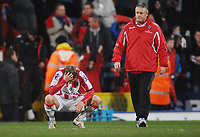 Football - Championship - Crystal Palace vs. Sheffield United 19/02/2010 Sheffield United Manager Mickey Adams consoles Bjorn Helge Riise at the final whistle.Credit : Colorsport / Andrew Cowie