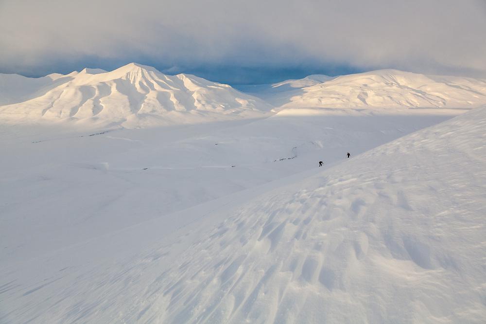 Kiya Riverman (left) and Mylène Jacquemart at sunset on Hallwylfjellet, Svalbard.