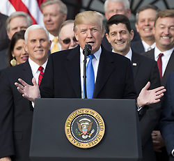 December 20, 2017 - Washington, District of Columbia, United States of America - United States President Donald J. Trump speaks on the South Lawn of the White House surrounded by United States Vice President Mike Pence and Republican members of Congress after the United States Congress passed the Republican sponsored tax reform bill, the 'Tax Cuts and Jobs Act' in Washington, D.C. on December 20th, 2017. Credit: Alex Edelman / CNP (Credit Image: © Alex Edelman/CNP via ZUMA Wire)