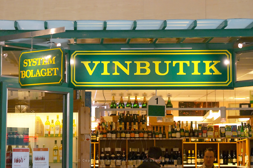 The sign in front of one of the Systembolaget shops. Systembolaget is the monopoly alcohol wine beer spirit retailer in Sweden. This store only sells wine according to the sign saying vinbutik (Wine Shop). Shelves with bottles on display. Stockholm, Sweden, Sverige, Europe