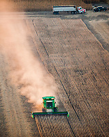 A farmer harvests soybeans in Isabella County.