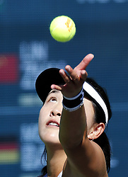 March 7, 2019 - Los Angeles, California, U.S - Lin Zhu of China, serves the ball to Mona Barthel of Germany, during the women singles first round match of the BNP Paribas Open tennis tournament on Thursday, March 7, 2019 in Indian Wells, California. Barthel  won 3-1. (Credit Image: © Ringo Chiu/ZUMA Wire)
