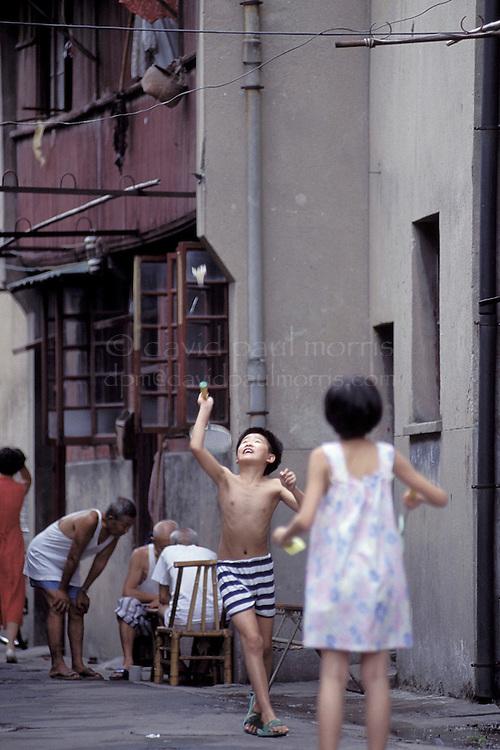 SHANGHAI, CHINA :  Kids play in a hutang area  in Shanghai, China. Photograph by David Paul Morris
