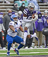 Defensive back Justin Gardner #6 of the Kansas State Wildcats intercepts a pass intended for running back Daniel Hishaw Jr. #20 of the Kansas Jayhawks and returns it for a touchdown, during the first half at Bill Snyder Family Football Stadium on October 24, 2020 in Manhattan, Kansas.