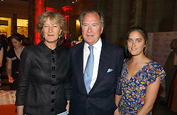 Left to right, MR & MRS PIERS VON WESTENHOLZ and their daughter VIOLET VON WESTENHOLZ at a party at the V&A museum, Cromwell Road, London for three exhibitions - Sixties Fashion, Sixties Graphics and Che Guevara:Revolutionary and icon held on 5th June 2006.<br />