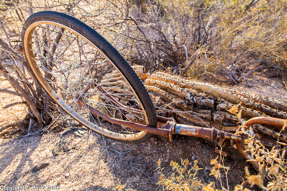"""03 MAY 2012 - VEKOL VALLEY, RURAL PINAL COUNTY, AZ:     An abandoned bicycle on Bureau of Land Management land south of Interstate 8 and west of Casa Grande in rural Pinal County. The area has been a hotbed of illegal immigrant and drug smuggling for years. The BLM has undertaken a series of """"surges"""" in the area, increasing their law enforcement patrols and partnering with Border Patrol and Pinal County Sheriff's Department officers to reduce criminal activity in the area. Smugglers have been known to use bicycles as well as cars to get through the desert.      PHOTO BY JACK KURTZ"""