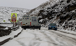 © Licensed to London News Pictures. 27/01/2012. Derbyshire, UK. A van slips on the ice with wheels spinning as the driver struggles with the impact of a severe snowfall along Derbyshire's notorious Snake Pass Road. Photo credit : Joel Goodman/LNP