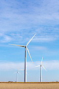 This photo shows wind energy production in rural America. Wind turbines in rural areas are part of the new sustainable energy future of the United States. Wind farms are not without controversy however, they produce another kind of pollution - the noise near a wind turbine array disturbs the quiet natural sounds of rural America.