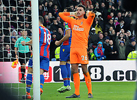 Football - 2017 / 2018 Premier League - Crystal Palace vs. Newcastle United<br /> <br /> Newcastle goalkeeper holds his hands to his head after failing to save the penalty kick of Luka Milivojevic, at Selhurst Park.<br /> <br /> COLORSPORT/ANDREW COWIE