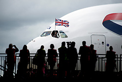 © London News Pictures. 04/07/2013 . London, UK.  Member of the media and British Airways staffwatch as the new British Airways AIRBUS A380 superjumbo arrives at Heathrow Airport. It was the first time British Airlines have taken delivery of the new plane, making British Airways the first European airline to operate both the 787 and A380. Photo credit : Ben Cawthra/LNP
