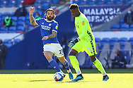 Nottingham Forest's Goalkeeper Brice Samba (30) under pressure from Cardiff City's Sheyi Ojo (27) during the EFL Sky Bet Championship match between Cardiff City and Nottingham Forest at the Cardiff City Stadium, Cardiff, Wales on 2 April 2021.
