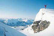 Alaska. Brooks Range. Skier on snowy mountain top above Alatna River (vrt)  MR