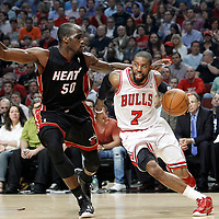 14 March 2012: Chicago Bulls point guard C.J. Watson (7) drives past Miami Heat center Joel Anthony (50) during the Chicago Bulls 106-102 victory over the Miami Heat at the United Center, Chicago, Illinois, USA.
