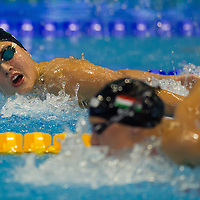 Zszsanna Jakabos (L) of Hungary is being overtaken by fellow Hungarian swimmer Katinka Hosszu (R ) during the Women's 400m Individual Medley final of the 31th European Swimming Championships in Debrecen, Hungary on May 21, 2012. ATTILA VOLGYI