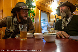 Danger Dan Hardick and Nick Huff of Knives By Nick out for Mexican in Red River, NM, USA. Saturday, May 29, 2021. Photography ©2021 Michael Lichter.