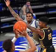 St Louis Billikens forward Jimmy Bell Jr. (32, left) calls for a pass as he is closely guarded by Arkansas-Pine Bluff Golden Lions forward Alvin Stredic Jr. (15). St. Louis University hosted the University of Arkansas - Pine Bluff in a mens basketball game on December 5, 2020 at Chaifetz Arena on the SLU campus in St. Louis, MO.<br /> Photo by Tim Vizer