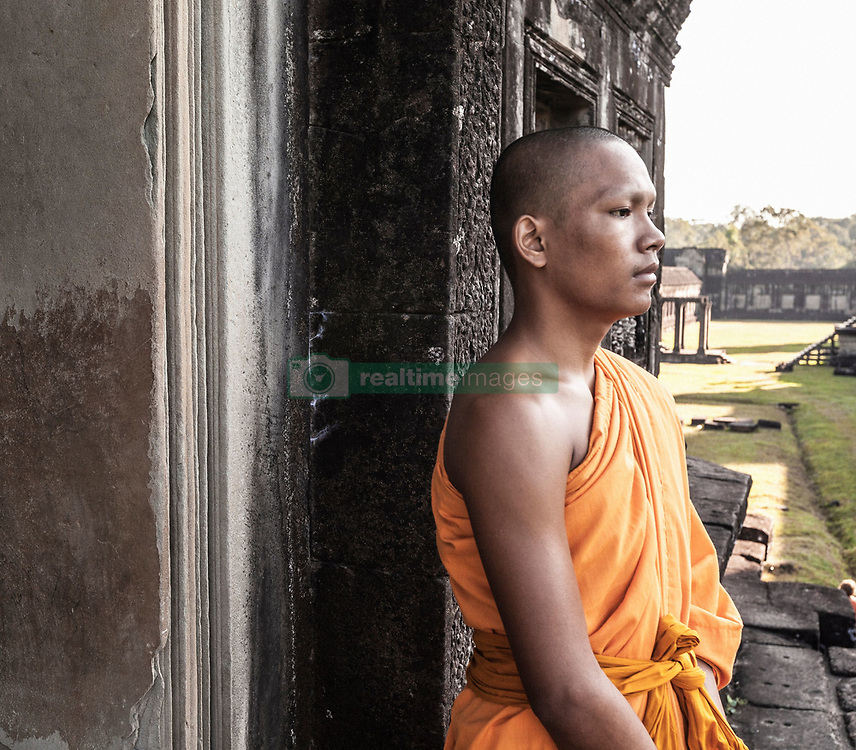 Aug. 2, 2013 - Young buddhist monk standing outside temple in Angkor Wat, Siem Reap, Cambodia (Credit Image: © Gary  Latham/Cultura/ZUMAPRESS.com)