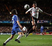 Photo: Paul Thomas.<br /> Chelsea v Valencia. UEFA Champions League. Quarter Final, 1st Leg. 04/04/2007.<br /> <br /> Andriy Shevchenko (Blue) of Chelsea and Asier Del Horno battle for the ball.