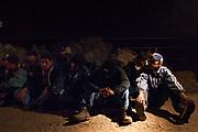 29 MARCH 2004 - NACO, ARIZONA: Undocumented immigrants in the custody of the US Border Patrol near Naco, AZ.      PHOTO BY JACK KURTZ